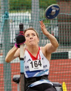 Josie Pearson, gold medalist discus thrower, uses her pink aid to steady herself while she competes.