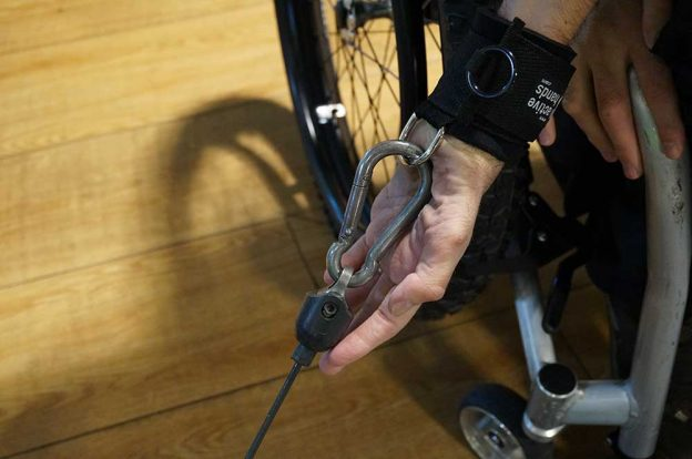 D-ring aid in gym attached to karabiner. Adaptive gym equipment. Suitable for reduced hand function: tetra, quad, cerebral palsy, SCI, spinal cord injury, limb difference, stroke and more.
