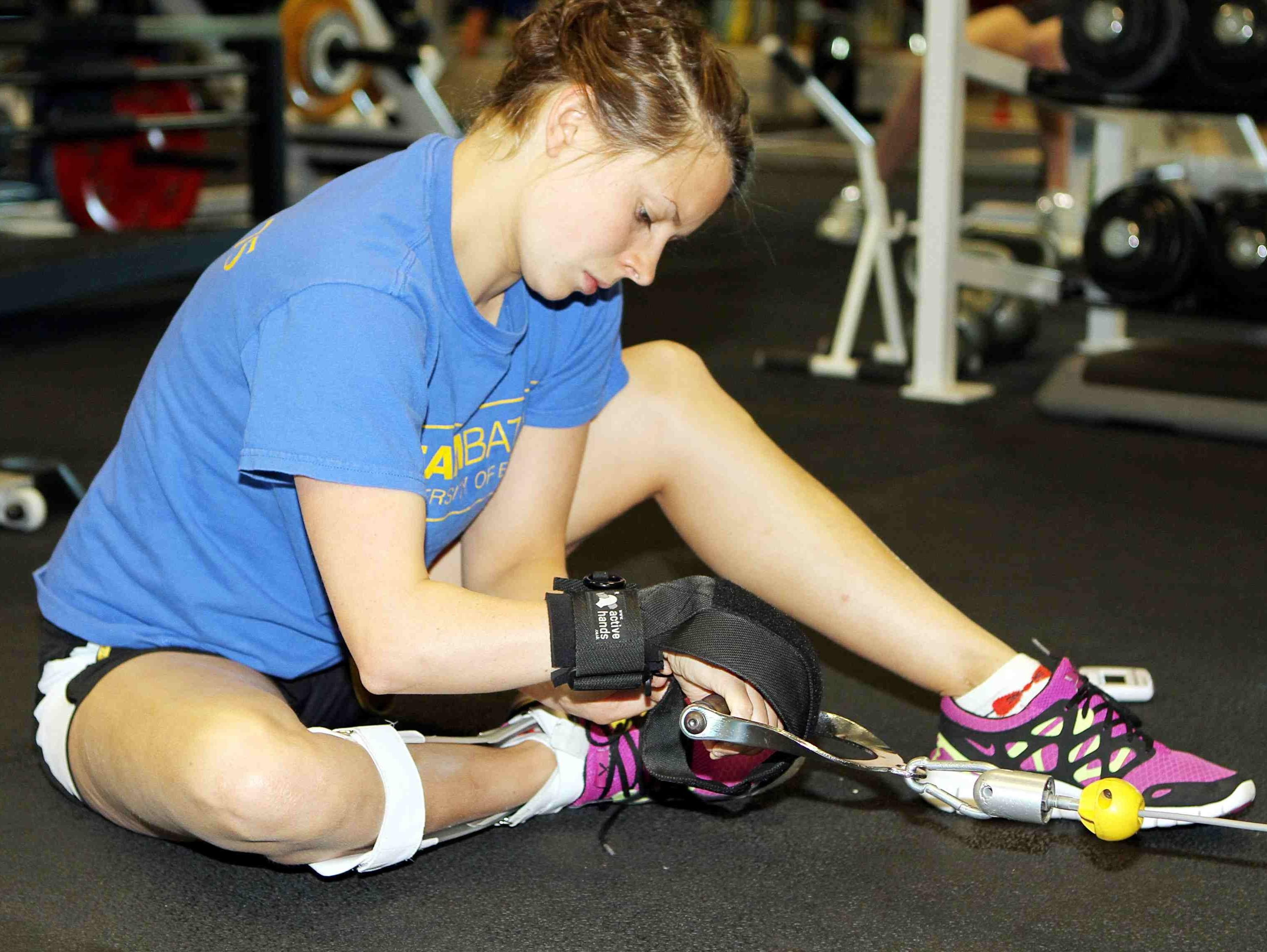 Liz Johnson using General Purpose gripping aids in gym