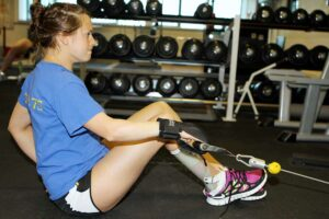 Liz Johnson, Paralympic swimmer, uses our gripping aids for training.