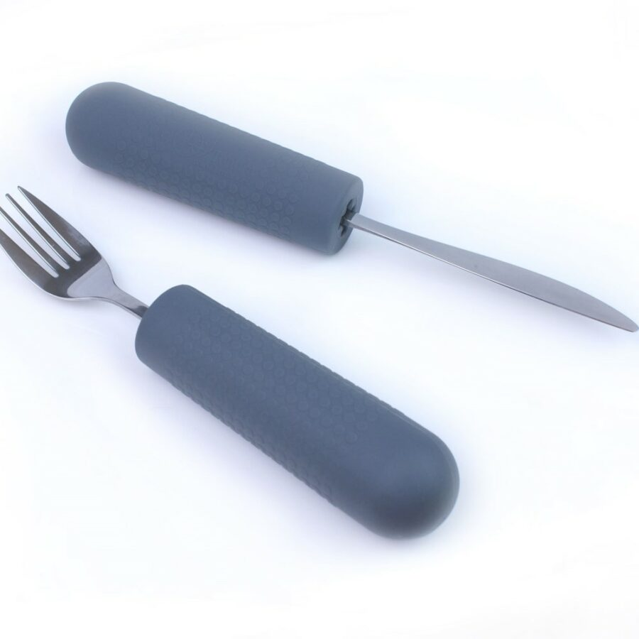 cutlery grips with knife and fork in. Suitable for reduced hand function: tetra, quad, cerebral palsy, SCI, spinal cord injury, stroke and more.