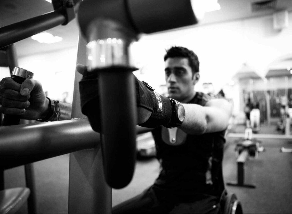 Mandip using General Purpose aids in gym
