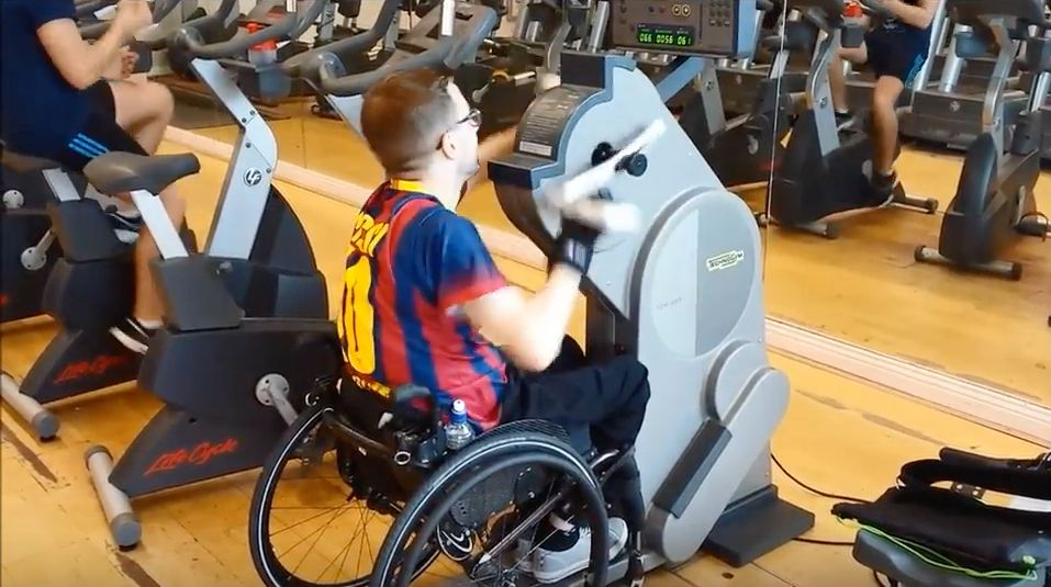 Gareth on handbike. Adaptive gym equipment. Suitable for reduced hand function: tetra, quad, cerebral palsy, SCI, spinal cord injury, stroke and more.