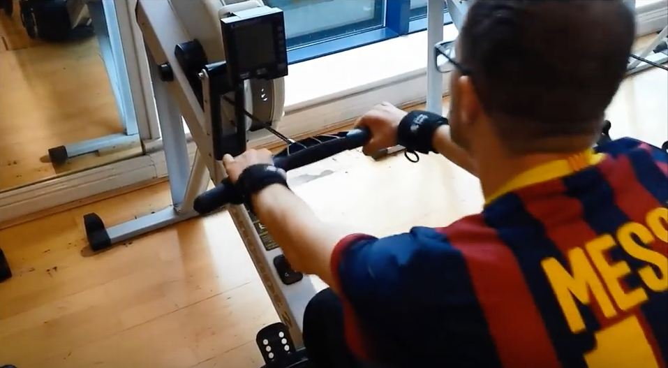 Gareth on rowing machine with Looped aids. Adaptive gym equipment. Suitable for reduced hand function: tetra, quad, cerebral palsy, SCI, spinal cord injury, stroke and more.