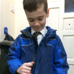 Zip grip zip pull on blue child's coat. Suitable for reduced hand function: tetra, quad, cerebral palsy, SCI, spinal cord injury, stroke and more.