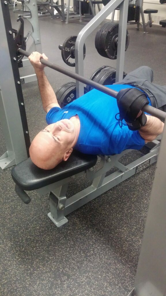 Jose in the gym with the General Purpose aid. Adaptive gym equipment. Suitable for reduced hand function: tetra, quad, cerebral palsy, SCI, spinal cord injury, limb difference, stroke and more.