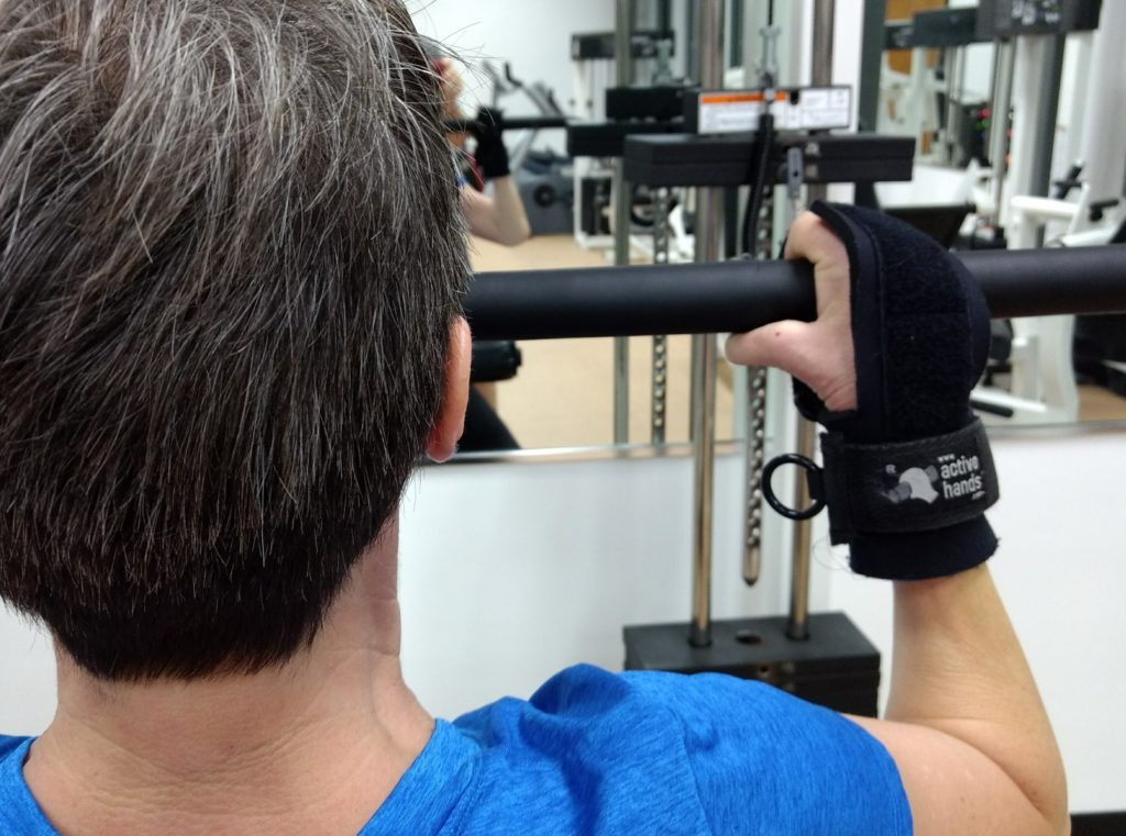 limb difference aid in action - disabled hands , disability aids , aids for disabled hands , grip aids , gripping aids , hand mobility aids , assistive devices for hands , handicapped aids , hand aids , adaptive gym equipment , limb difference , missing fingers , deformed hands , deformed fingers