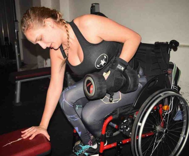 Alex using General Purpose aid in gym. Adaptive gym equipment. Suitable for reduced hand function: tetra, quad, cerebral palsy, SCI, spinal cord injury, stroke and more.