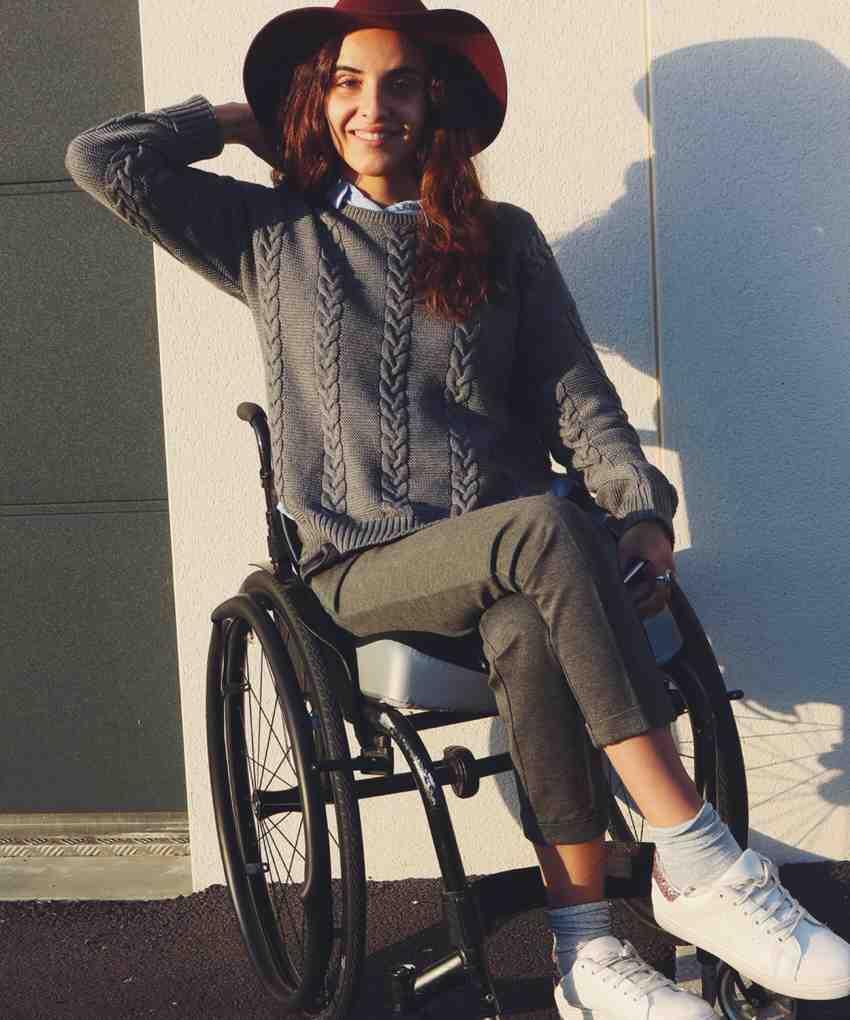 Oksana wearing hat in wheelchair