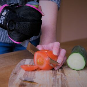 multi-purpose right-angle handled kitchen knife chopping salad. Suitable for reduced hand function: tetra, quad, cerebral palsy, SCI, spinal cord injury, stroke and more.