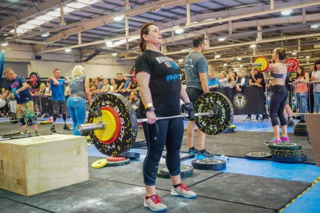 Tina weight lifting with Limb Difference aid