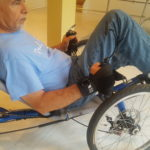 Jose uses his stroke glove for hand cycling