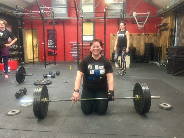 Tina weightlifting with Limb Difference aid