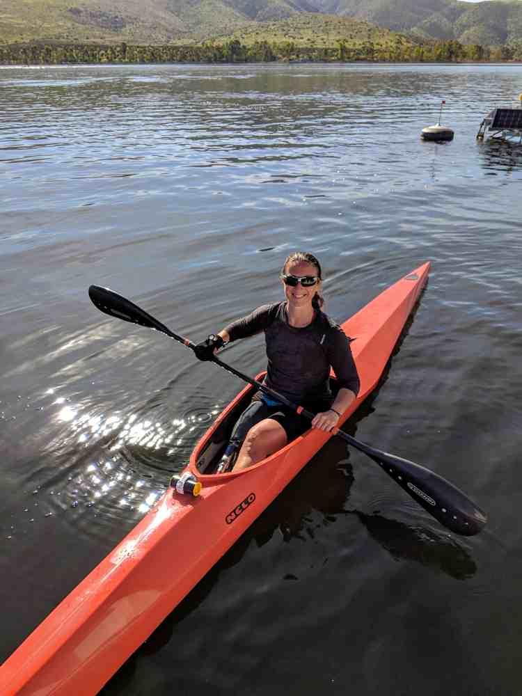 Jillian Kayaking with gripping aids on oar.