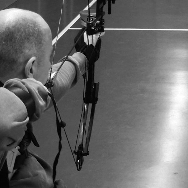 Damien using the General Purpose aid with his archery bow