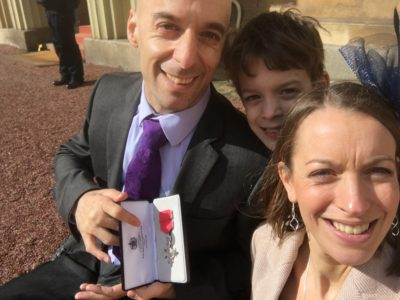 Rob with his MBE medal, wife and son