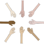 Hands of different skin tones all reaching into a circle