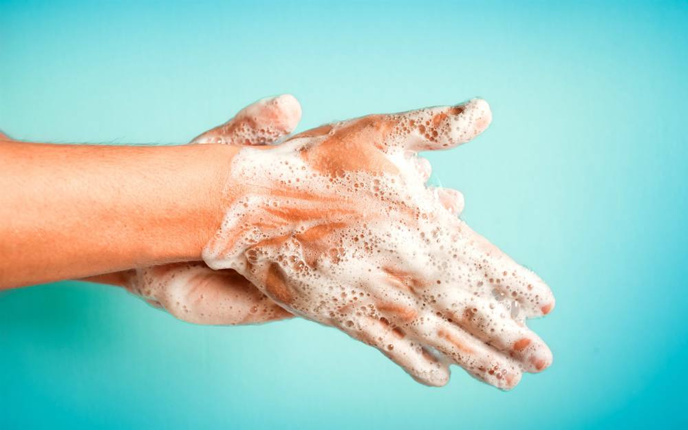 image of hand washing