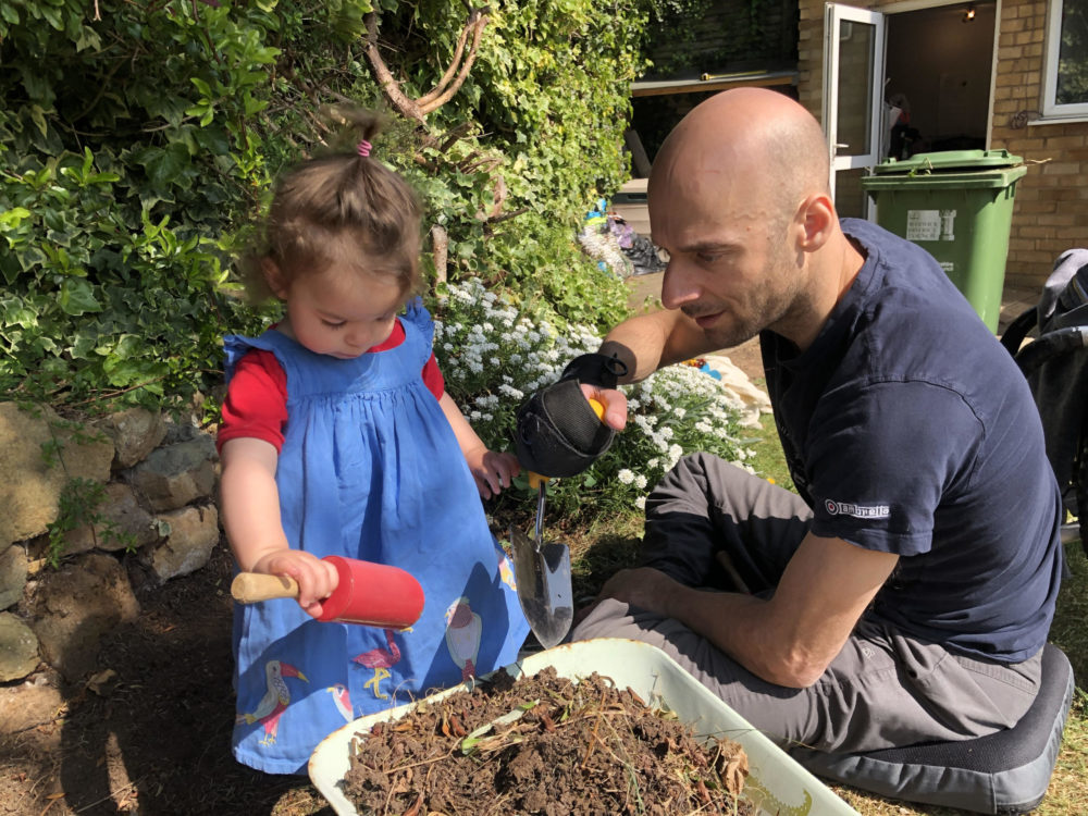Rob and his daughter gardening together