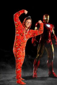 man in an ironman onesie