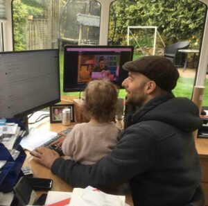 Rob works with his daughter on his lap!