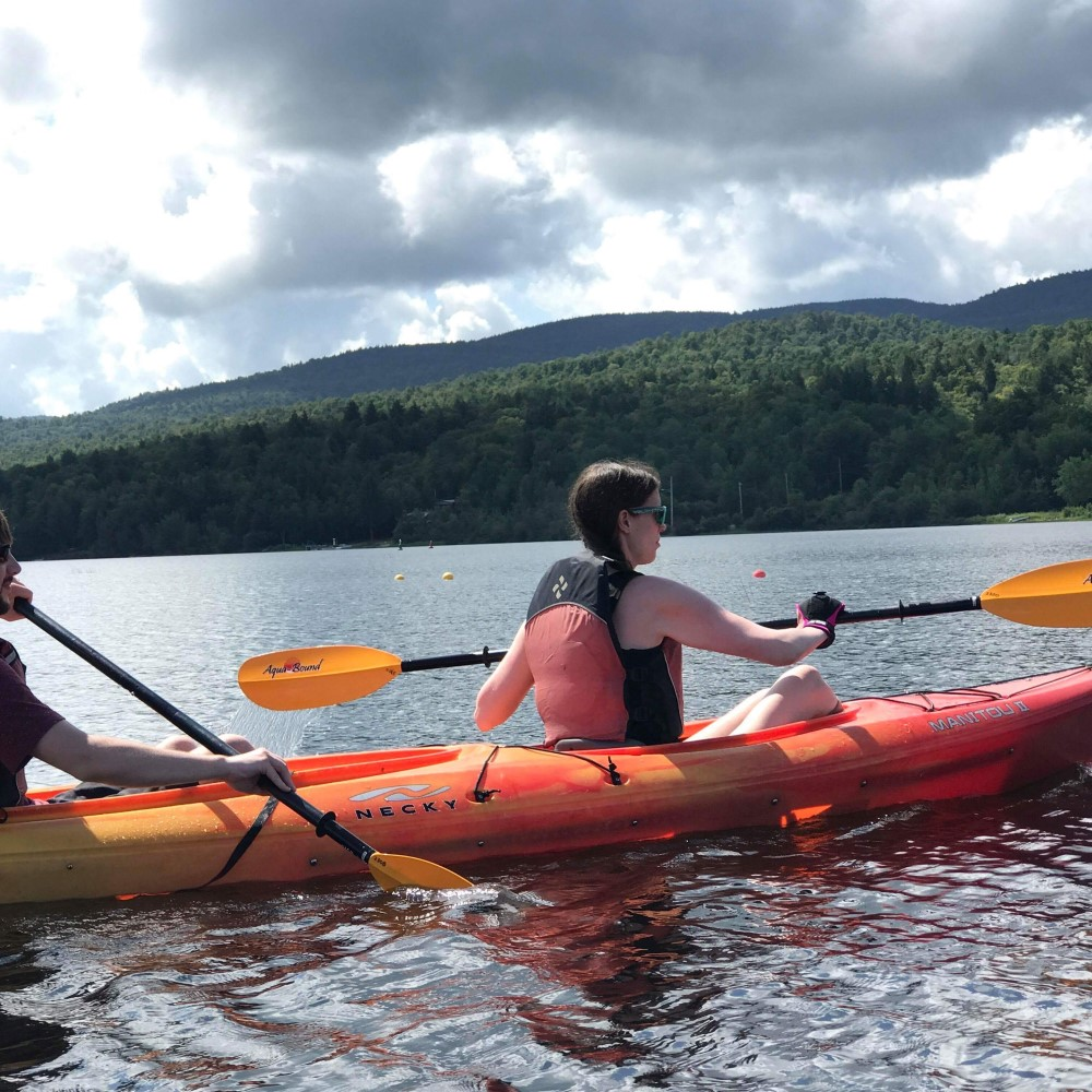 Kasey uses a pink general purpose gripping aid to hold her kayak paddle