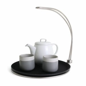 tipsy tray with tea pot and cups on