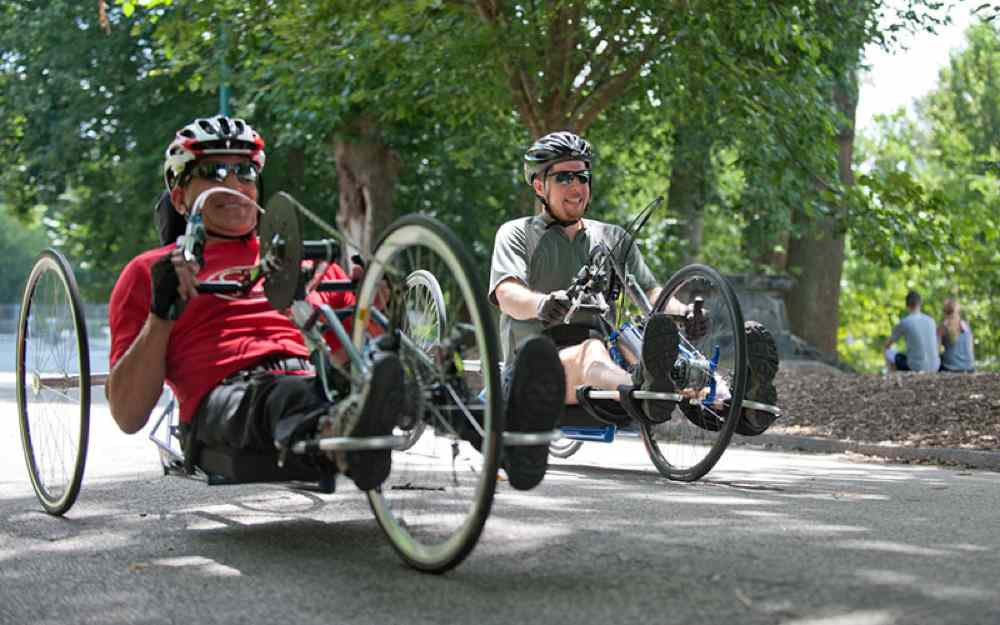 Two men out on hand bikes