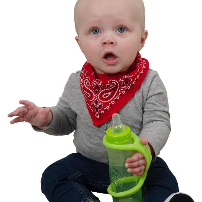 Image shows a baby sitting up and holding onto a drinking bottle which has an eazyhold strap on it.