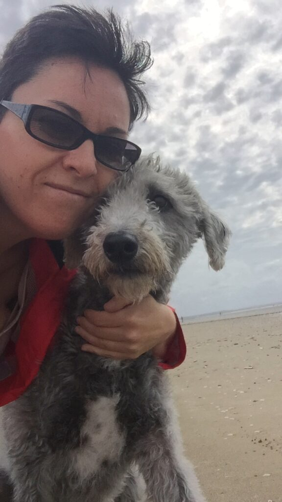 Nat with her dog Stan at the beach