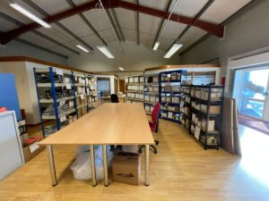 the new office has a dispatch area with tables and racking